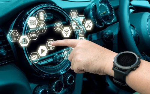 Smart car and internet of things (IOT) concept. Finger point to car 's console and icons popup out of screen.